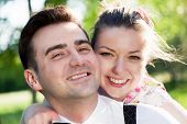 picture of fiance  - Young smiling couple in love portrait in summer park - JPG