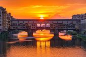 picture of bridges  - River Arno and famous bridge Ponte Vecchio at sunset from Ponte alle Grazie in Florence - JPG