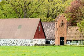 foto of barn house  - Old telegraph or telephone switch house beside farm houses and barns - JPG