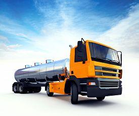 foto of fuel tanker  - 3d illustration of big orange fuel tanker truck - JPG