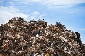 pic of scrap-iron  - Scrap metal ready for recycling over blue sky - JPG