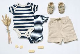 stock photo of apparel  - top view fashion trendy look of baby clothes and toy stuff baby fashion concept - JPG