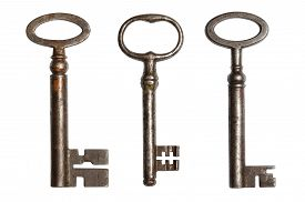 stock photo of skeleton key  - Three ancient keys isolated on white background - JPG