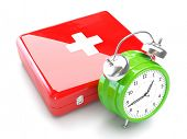 Medical Concept With Clock and First Aid Kit isolated on white background