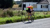 Competor/ Athletic Taking Part In Road Cycle Racing