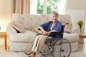 stock photo of amputation  - Retired woman in her wheelchair at home - JPG