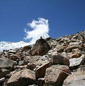 Snowcowered high cordillera mountain and stone