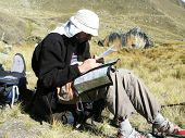 male looling maps in Cordilleras mountain