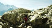 Climber the climb on big stone
