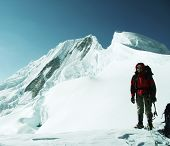 Climber on Quitaraju peak background