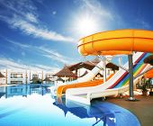 Colorful aquapark constructions in swimming-pool