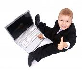 Little child and laptop Isolated on white background