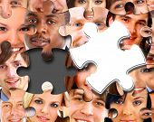 pic of brain-teaser  - Group of business people in pieces of a puzzle - JPG