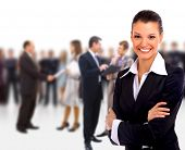 picture of leader  - Female Business leader standing in front of her team - JPG