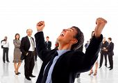 stock photo of overjoyed  - One very happy energetic businessman with his arms raised - JPG