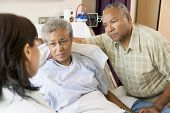 Doctor Talking To Senior Couple