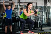 Group of men and woman in functional training gym doing fitness exercise poster