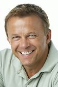 stock photo of middle-age  - Middle Aged Man Smiling - JPG