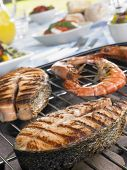 Salmon And Prawns Cooking On A Grill