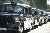 image of hackney  - London Taxis Lined Up On Sidewalk - JPG