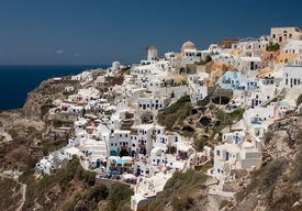 pic of greek-island  - Colorful Oia city on Santorini island with windmill - JPG