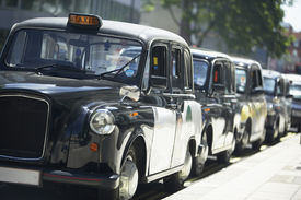 pic of hackney  - London Taxis Lined Up On Sidewalk - JPG
