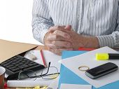 Dishevilled Busy Man At Chaotic Desk - Overwork