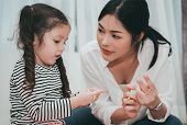 Mother Teach Daughter Counting Numbers Finger, Parent And Kid Education Preschool Or Kindergarten Tu poster