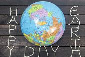 Concept-earth Day. Globe With The Text: Happy Earth Day. poster