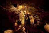 Huge Stalagtites And Columns In A Cave