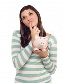 Pretty Ethnic Female Daydreaming and Holding Pink Piggy Bank Isolated on a White Background.