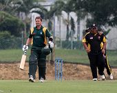 PUCHONG, MALAYSIA - SEPT 24: Guernsey's batsman Adam Martel leaves the field in this Pepsi ICC World