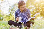 The Girl Sitting On A Green Grass With Cup Of Coffee And Reads The Book. Read Book Woman Summer Outs poster