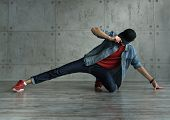 Teenager Guy In Denim Jacket And Baseball Cap, Jeans And Red Sweater Dances Of Break Dance. Dynamics poster