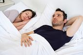 Sad Man On The Bed Depressed For Sexual Problem With His Girlfriend poster