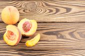 One Whole Peach And Two Half Of Fresh Ripe Peach With Peach Stone And One Slice Of Peach On Rustic O poster