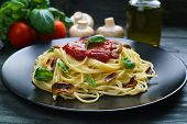 Prepared Spaghetti Pasta With Tomato Sauce, Roasted Champignons And Basil Leaves On Black Plate. Ita poster
