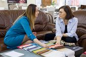 Interior Designer And Client-adult Woman Matching Color Samples Of Fabrics For Curtains, Home Textil poster