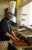 Постер, плакат: Шеф повар приготовление пищи с улыбкой