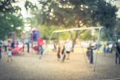 Blurred Motion Kids Swing Back And Forth At Public Playground In Usa poster