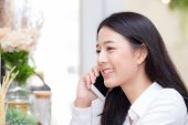 Beautiful Young Asian Woman Talking Phone And Smile In The Coffee Shop, Businesswoman Sitting In Caf poster