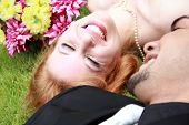 Bride Groom Lying On The Grass