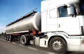 Fuel Tanker truck driving on country-road/motion