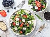 Salad With Arugula, Feta Cheese And Berries - Strawberry, Blueberry, In Craft Plate On Gray Cement B poster