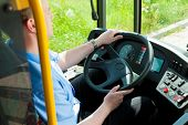 stock photo of bus driver  - Bus driver sitting in his bus on tour - JPG
