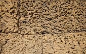 Rough Stone Ancient Wall Closeup Photo. Stone Wall Texture. Rustic Stone Wall Of Ancient Building. G poster