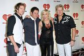 LAS VEGAS - SEPTEMBER 24: Natasha Bedingfield with Rascal Flatts on the red carpet at the 2011 iHeartRadio Music Festival on September 24, 2011 at the MGM Grand Garden Arena in Las Vegas, Nevada.