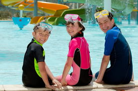 image of playmate  - Three kids sitting poolside - JPG