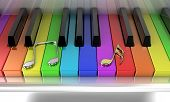 stock photo of rainbow piano  - The white piano with keys of different colours of a rainbow - JPG