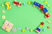 Baby Kids Toys Background. Wooden Educational Geometric Stacking Blocks Toy, Wooden Train, Cars, Sta poster